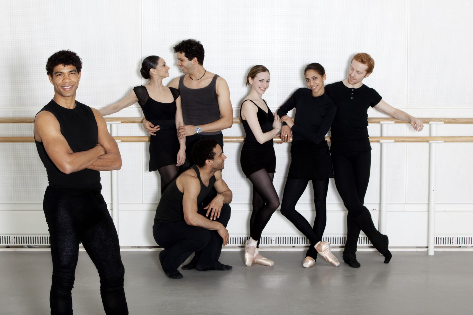 ballet dancers in rehearsal clothes with Carlos Acosta