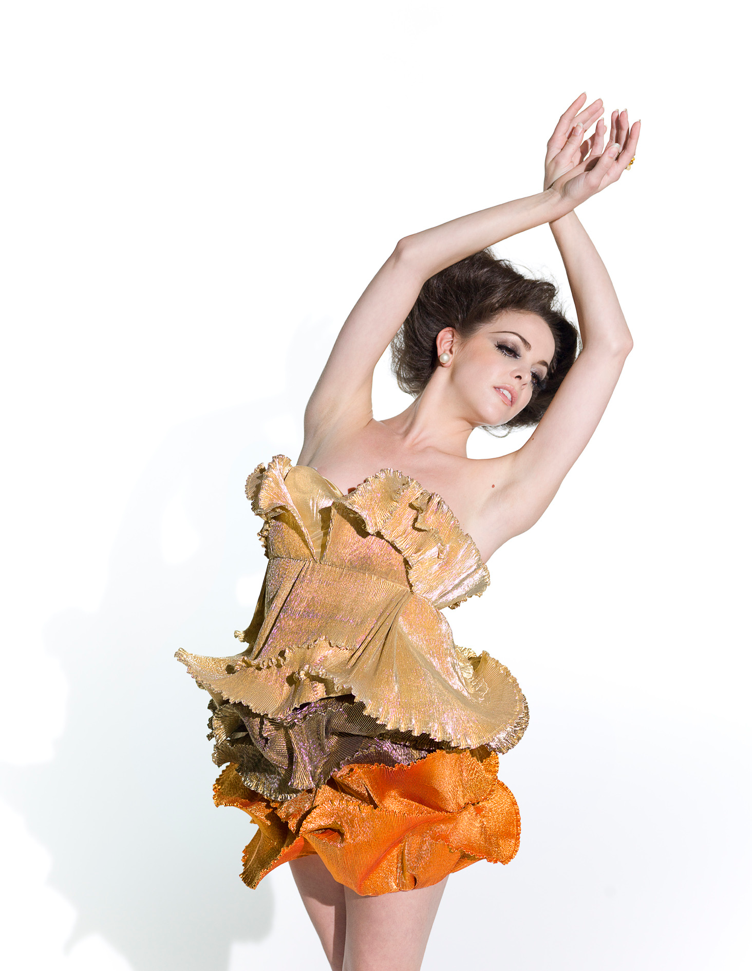 dancer wearing orange dress from English National Ballet