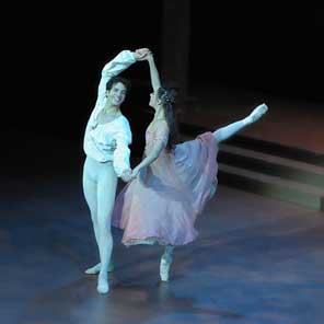 two dancers perform ballet