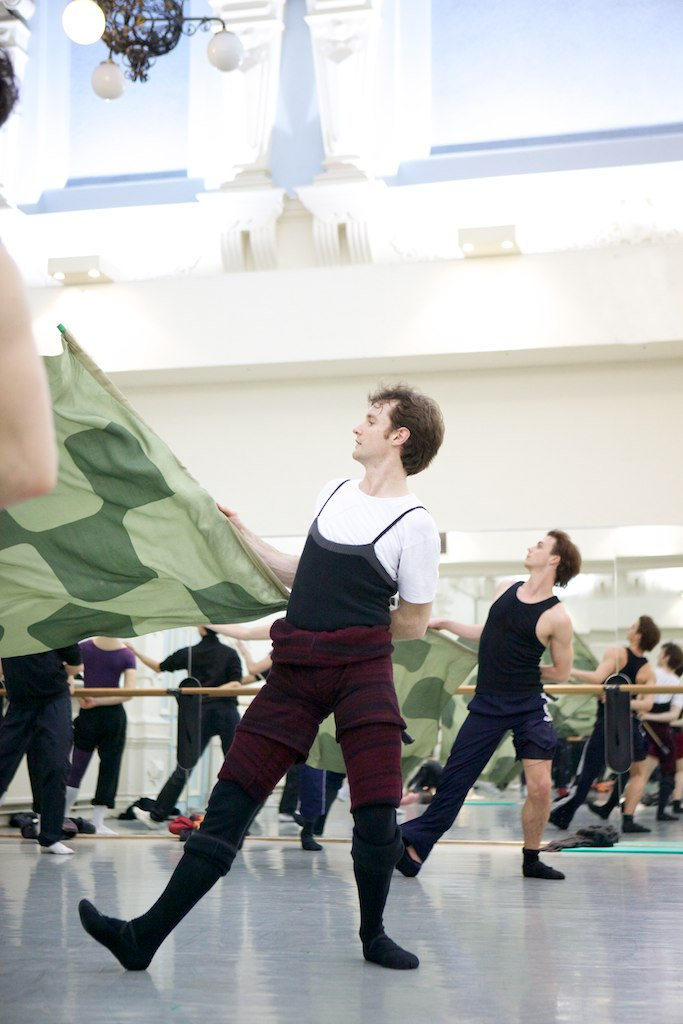dancer rehearsing with a flag