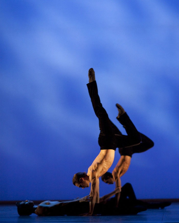 two dancers in handstand on stage
