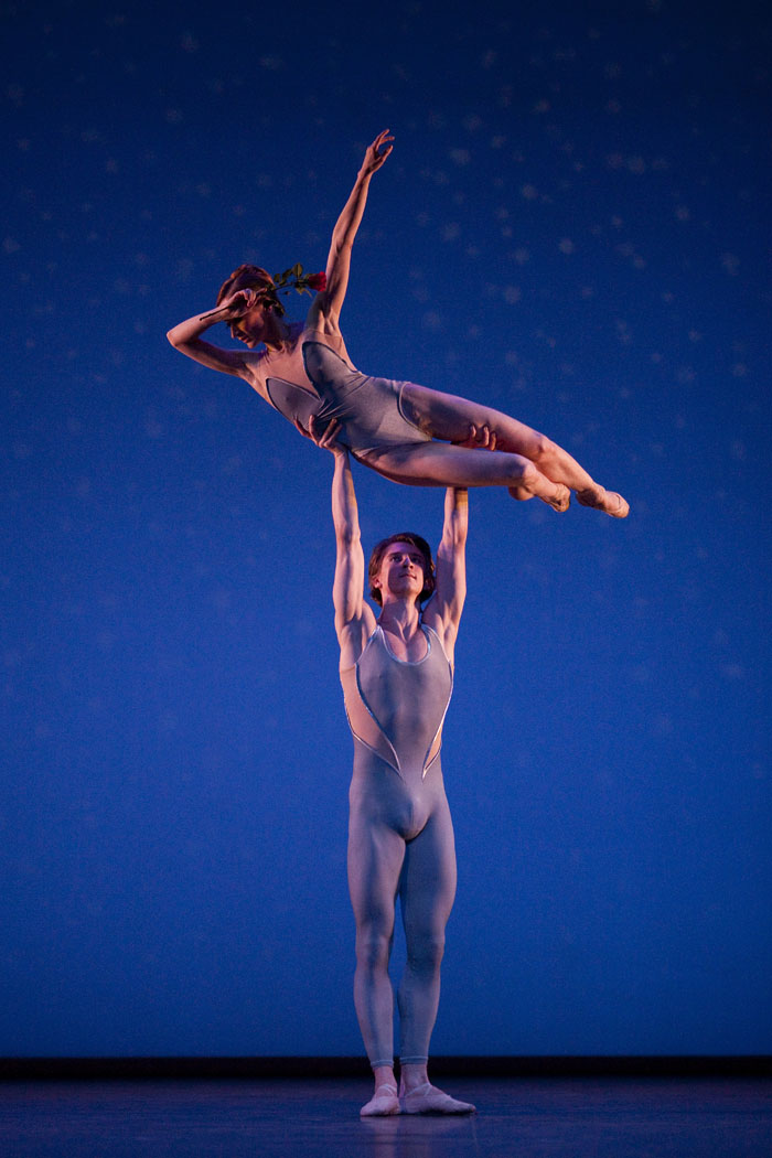 two dancers in a high overhead lift