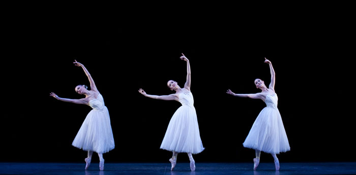 three dancers on stage in white