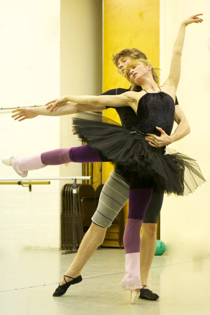 two dancers in arabesque rehearsing Swan Lake