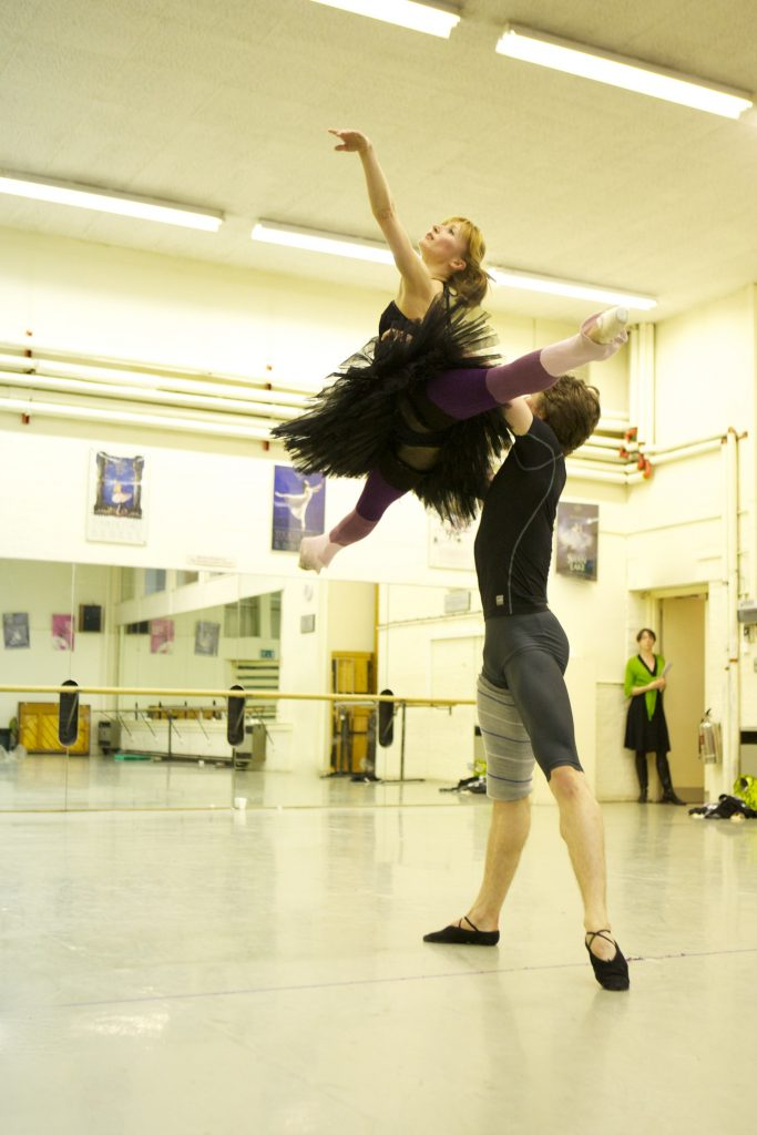 dancers jump in the air in ballet rehearsals