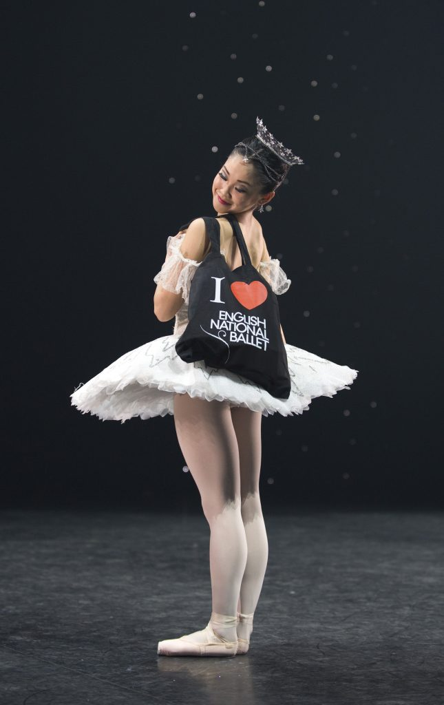 ballet dancer holds a ballet bag