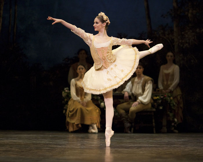 ballet dancer in tutu in arabesque
