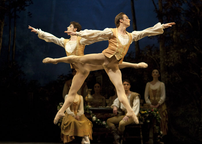 two male ballet dancers in high jump
