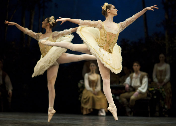 two female dancers in arabesque