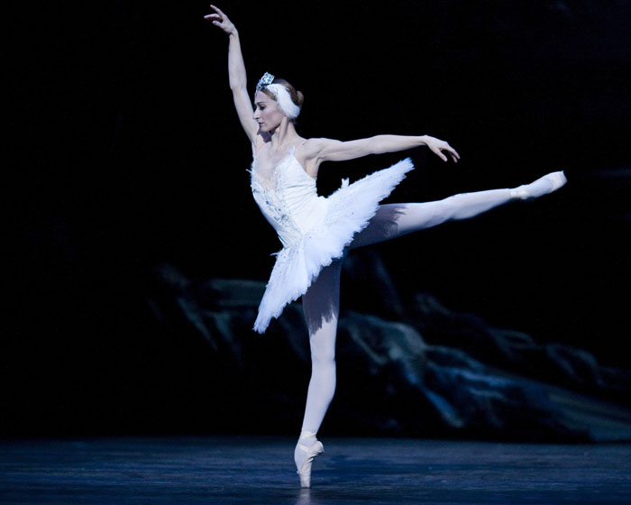 dancer in arabesque in white tutu
