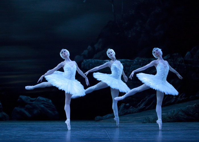 three dancers in white tutus