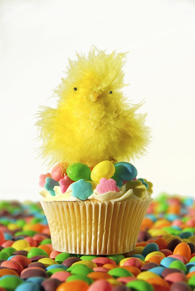 an easter chick sat on a cupcake