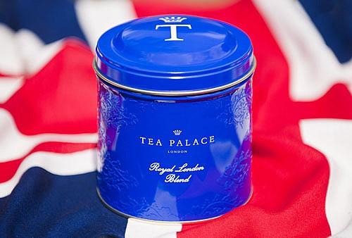 bright blue tea caddy sitting on a Union Jack flag