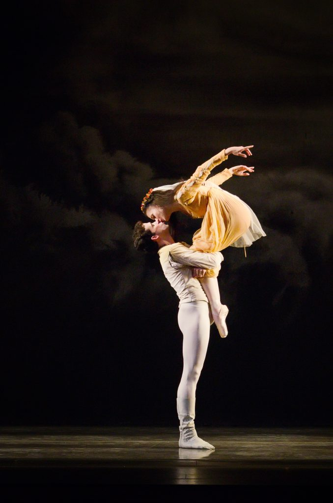 one dancer holds another on stage