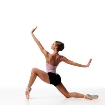 ballet dancer kneels on the floor