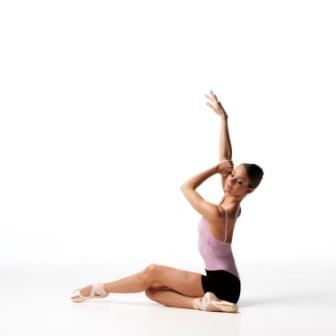 dancer sits on the floor