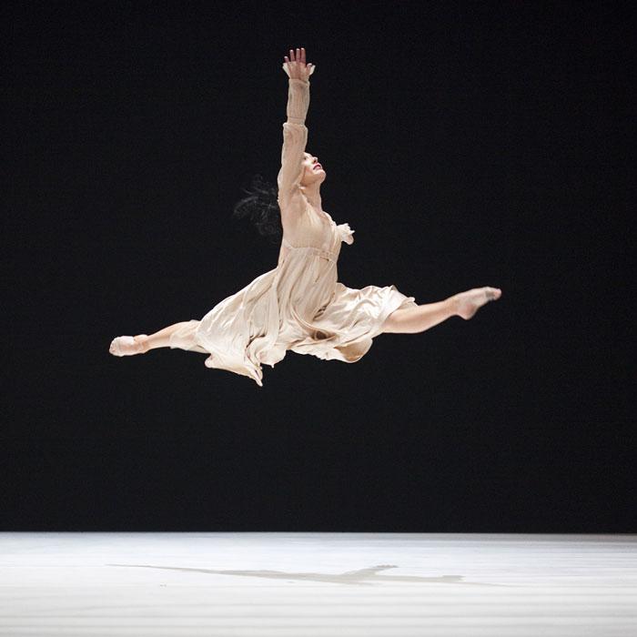 ballet dancer jetes on stage