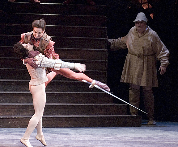 two ballet dancers sword fighting