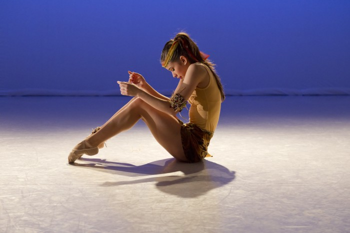 ballet dancer sits on stage